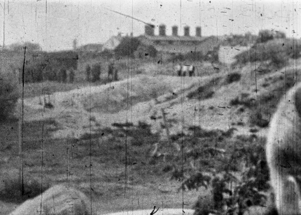 A grainy still image shows the shooting of Jews in Libau (Liepaja), Latvia from where bystanders look on at the murders.